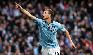 Edin Dzeko salutes the Manchester City fans